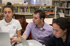 Adrian Skrentny helps students begin to code in Java