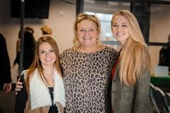 Recent CPA graduates visit with faculty member, Sallie Wallace at the Young Alumni Christmas Luncheon.